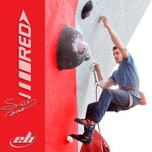 Seb Bouin sur mur d'escalade